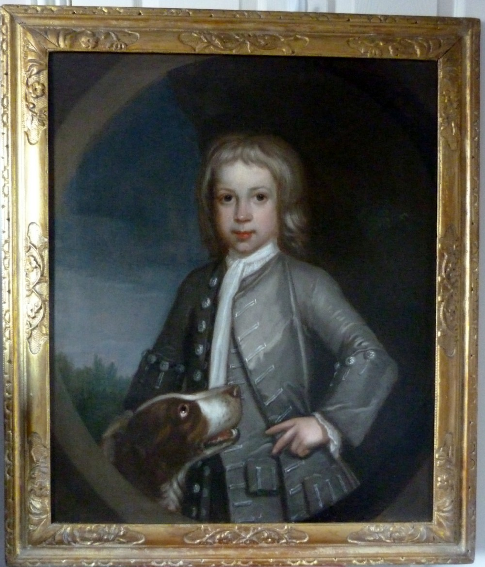 portrait of a young boy with a dog c1740 english school