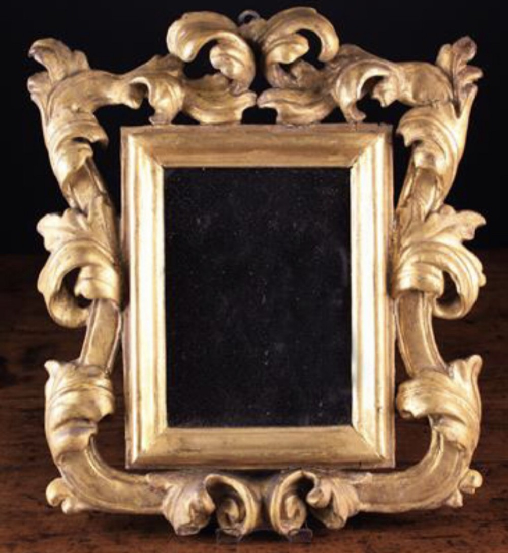 small 17th century carved giltwood mirror